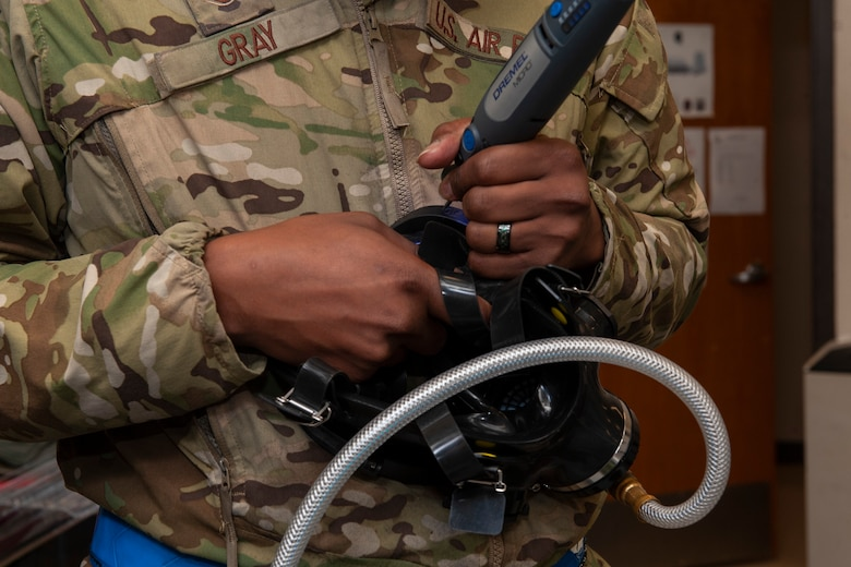 Photo of an Airman carving a respirator