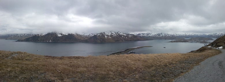 Panoramic view overlooking Dutch Harbor and Iliuliuk Bay with Unalaska in the distance. The final feasibility study recommends deepening the existing bar to -58 feet providing one-way access for ships with a draft up to 44 feet. Currently, the bar accommodates vessels with a draft of 38 feet. (Photo by Chris Hoffman, USACE - Alaska District)