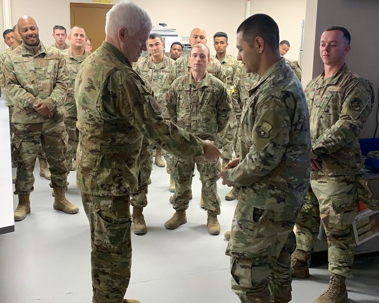 Lt. Gen. L. Scott Rice, Director of the Air National Guard, coined Senior Airman Ricky Martinez, 386th Expeditionary Communications Squadron, recognizing his contributions to the mission while deployed to Ali Al Salem Air Base, Kuwait Dec. 28, 2019.