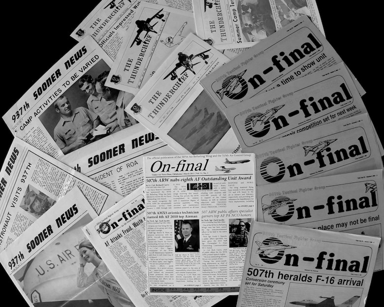 Printed copies of the Sooner News, Thunderchief and On-final newspapers are displayed on a table Feb. 7, 2020, at Tinker Air Force Base, Oklahoma. The 507th Air Refueling Wing Public Affairs office published 30 years worth of historic newspapers in January of this year. (U.S. Air Force photo by Tech. Sgt. Samantha Mathison)
