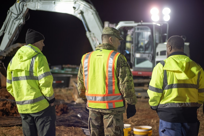 Col. Marvin L. Griffin, Huntsville Center commander, center, talks with the professionals working on a chemical warfare materiel remediation project at Redstone Arsenal, Alabama, Jan. 16, 2020, for which Huntsville Center's Chemical Warfare Design Center is serving as executing agent.