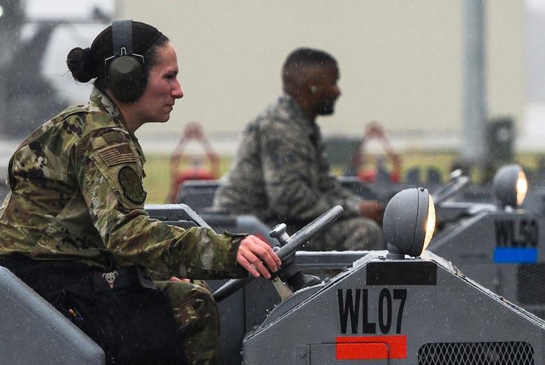 Senior Airman Breanna Miller operates a bomb loader