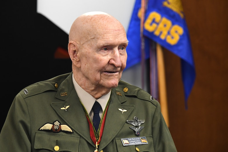 U.S. Air Force retired Col. Gail S. Halvorsen, the Berlin Candy Bomber, speaks to Airmen assigned to the 821st Contingency Response Squadron during his visit to Travis Air Force Base, California, Jan. 31, 2020. Halvorsen spoke about the importance of being a part of the airlift team and told Airmen there was no greater service than to save the lives of others. (U.S. Air Force photo/ TSgt Liliana Moreno)