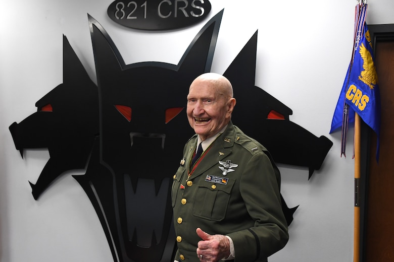 """U.S. Air Force retired Col. Gail S. Halvorsen, the Berlin Candy Bomber, gives a thumbs-up to the crowd, Jan. 31, 2020, Travis Air Force Base, California. The 99-year old war hero shared his amazing story with the Airmen and as a tribute to his legacy, he was inducted into the squadron's """"Super Howl"""" hall of fame. The Super-Howl was initiated by the squadron as a way to recognize military veterans who visit their unit and have played an important role in the nation's history. The squadron displays this honor on a plaque at the unit where they add the name of the inductee next to the operation he or she served in. (U.S. Air Force photo/ TSgt Liliana Moreno)"""