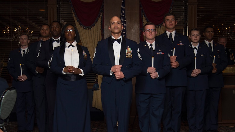 U.S. Air Force Airmen stand in a formation during a candle lighting ceremony at the Chief's Induction Ceremony, Jan. 31, in Tampa, Fla. The formation included nine Airmen to signify each of the nine ranks of the enlisted Air Force structure.