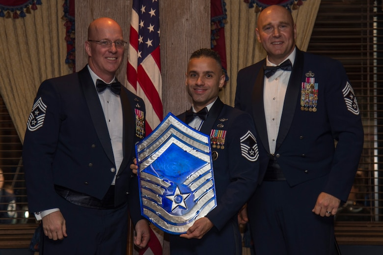 U.S. Air Force Chief Master Sgt. Daniel Simpson, the 18th Air Force command chief (left), chief master sergeant select, Senior Master Sgt. Jorge Bonilla, the Joint Special Operations University enterprise management course director (center) and Chief Master Sgt. Anthony Green, the 6th Air Refueling Wing command chief (right), pose for a photo, during a Chief's Induction Ceremony, Jan. 31, in Tampa, Fla.  Bonilla was one of nine Team MacDill Airmen selected for promotion to chief master sergeant for 2019.