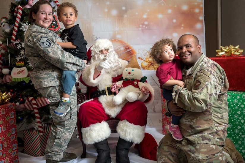 A family poses with Santa Claus.