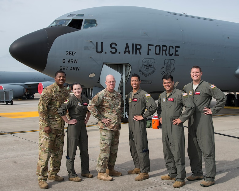 U.S. Air Force Chief Master Sgt. Daniel Simpson, the 18th Air Force command chief, pauses for a photo with 50th Air Refueling Squadron aircrew at MacDill Air Force Base, Fla., Jan. 30, 2020.
