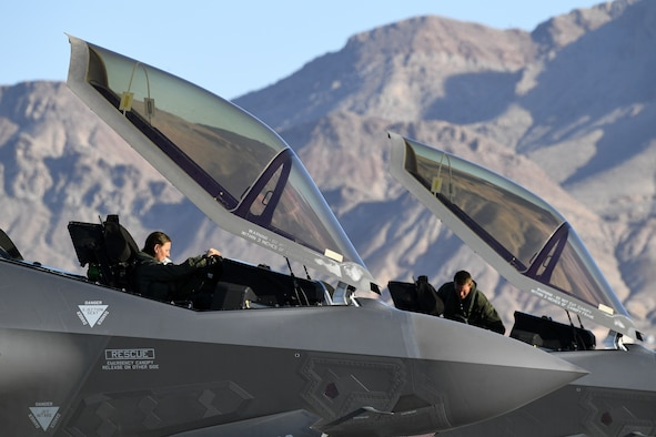 A photograph of pilots in the cockpit of F-35A Lightning II aircraft.