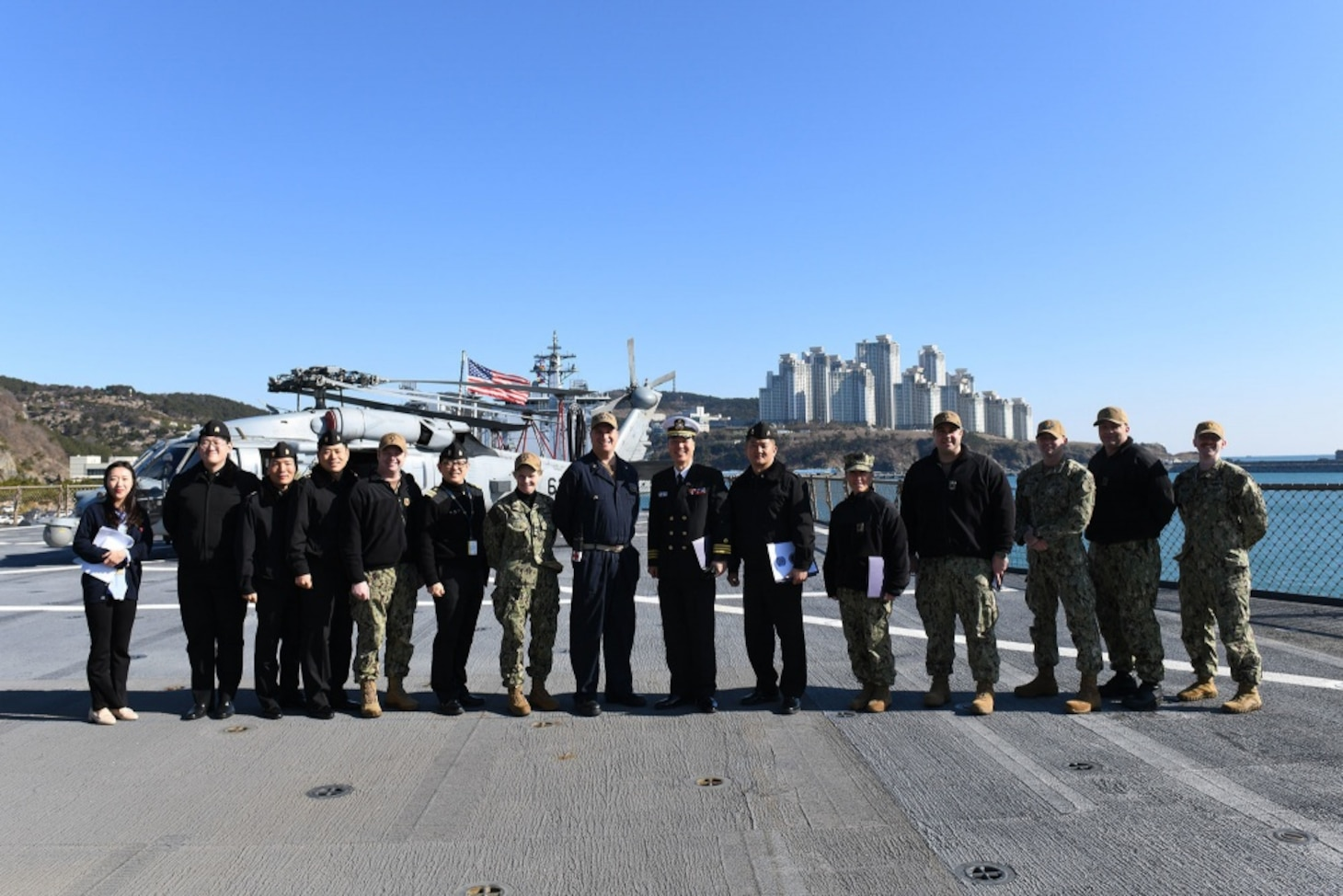 U.S. 7th Fleet and Blue Ridge Sailors pose for a photo with Republic of Korea Navy personnel prior to a medical demonstration held aboard U.S. 7th Fleet flagship, USS Blue Ridge. Blue Ridge with embarked U.S. 7th Fleet Sailors arrived in Busan, Republic of Korea (ROK) for a regularly scheduled port visit Feb. 5. During their visit they will engage in local culture, hose military-to-military engagements and build relationships through music and public service activities.