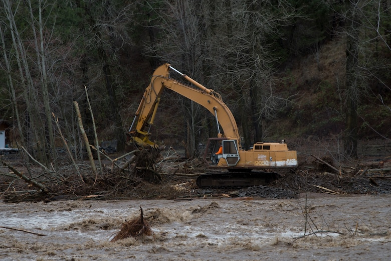 Excavator removes debris from Mill Creek Channel.