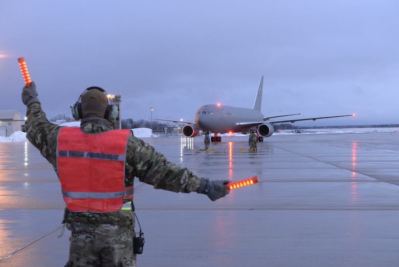 New Hampshire Air National Guard Staff Sgt. Joseph Chase, a flightline crew chief with the 157th Maintenance Squadron, marshals the Wing's fifth and newest KC-46A Pegasus air refueling tanker upon its arrival from Boeing, Feb. 7, 2020. Pease is slated to receive another seven aircraft in 2020. (U.S. Air National Guard photo by Tech. Sgt. Aaron Vezeau)