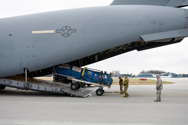 U.S. Air Force Master Sgt. Lewis Smith, the traffic management supervisor assigned to the Ohio National Guard's 180th Fighter Wing, and U.S. Air Force Tech. Sgt. Adam Berry, a vehicle maintenance technician assigned to the 180FW, load cargo onto a C-17 assigned to the 167th Airlift Wing at the 180FW, Feb. 4, 2020. The C-17 was loaded with equipment to support the 180FW's involvement in exercise Green Flag-West. Green flag is a realistic, Air-to-Surface, joint training exercise designed to improve interoperability between aircraft while supporting ground troops by allowing U.S. military branches, as well as other NATO and allied nations, an opportunity to work together, as they would in military operations around the world.