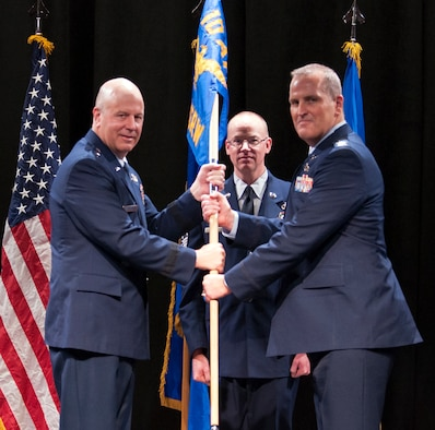 Maj. Gen. Brian Borgen, 10th Air Force commander, passes the guidon to Col. Joseph Marcinek, incoming commander for the 655th Intelligence, Surveillance, and Reconnaissance Wing, during a change of command ceremony held at the Carney Auditorium, National Museum of the United States Air Force, Feb. 8, 2020. Col. Marcinek had served as the deputy commander for the wing. (U.S. Air Force photo/Senior Airman Angela Jackson)