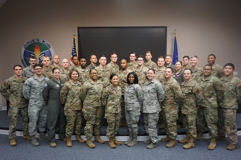 Graduates of Airman Leadership School Class 20-B stand for a group photo.