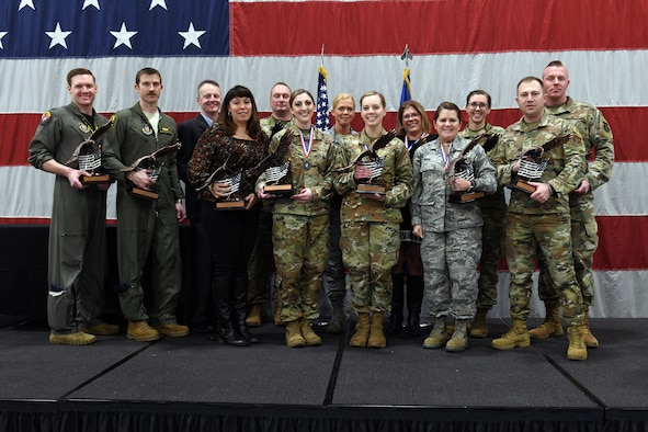 Winners from the 419th Fighter Wing's annual awards banquet take the stage Feb. 9 at Hill Air Force Base, Utah