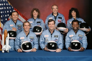 """Space Shuttle Challenger, STS-51L, Crew (l-r): Mission Specialist Ellison S. Onizuka, Pilot Michael J. Smith, Payload Specialist Christa McAuliffe, Commander Francis R. """"Dick"""" Scobee, Payload Specialist Gregory B. Jarvis, Mission Specialist Judith A. Resnik, Mission Specialist Ronald E. McNair. (Photo courtesy of NASA)"""