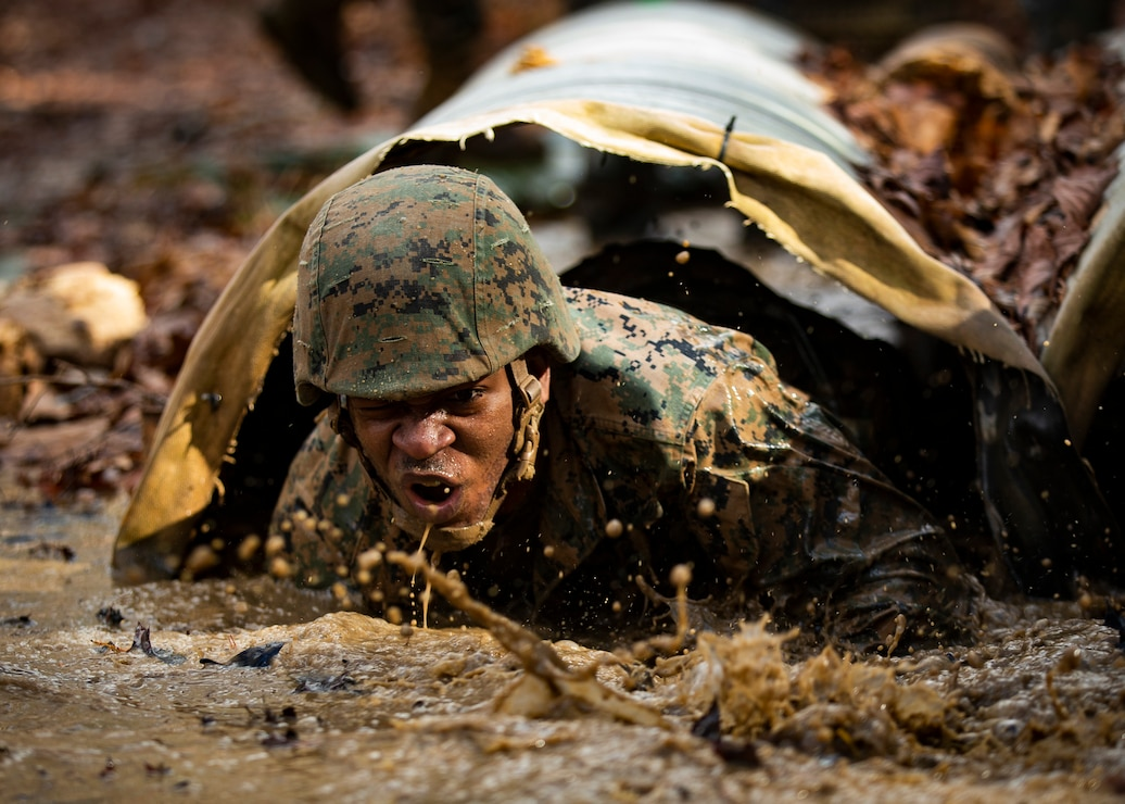 U.S. Marines from Corporals Course 615-20 go through the obstacle endurance course at Marine Corps Base Quantico, Va., Feb. 7.