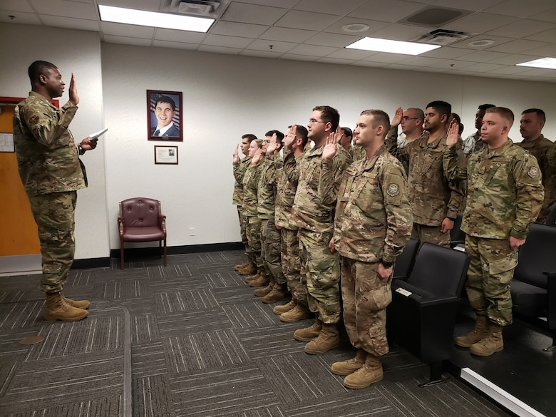 U.S. Air Force Chief Master Sgt. Kevin Richardson, 19th Maintenance Group superintendent, issues the Dedicated Crew Chief pledge during a formal induction ceremony.