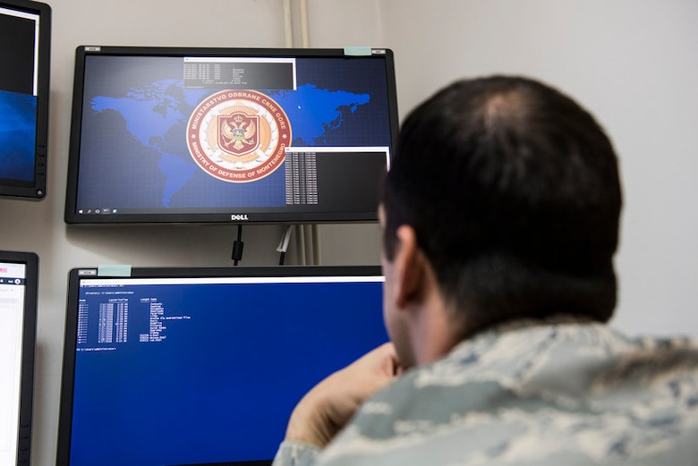 A U.S. Cyber Command Airman reviews simulated cyber threat information during Cyber Defensive Cooperation at Podgorica, Montenegro, Sept. 28, 2018. (U.S. Air Force courtesy photo by U.S. Army Spc. Craig Jensen)