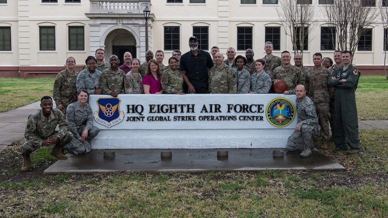 "Karl ""the Mailman"" Malone and members from ""The Mighty Eighth"" Air Force and Joint-Global Strike Operations Center stand outside the headquarters building following a Leadership Lab, Feb. 4, 2020. Malone received a firsthand look at global bomber and NC3 operations during a visit to the numbered air force, which is located at Barksdale AFB, La. Malone is also a local area resident."