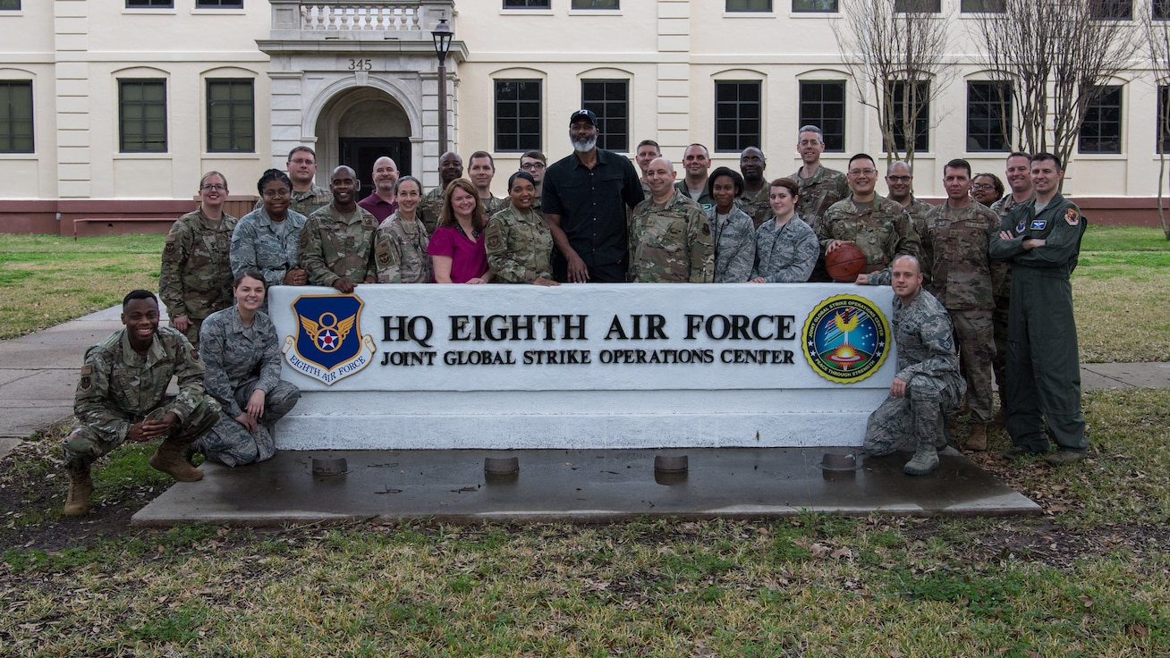 """Karl """"the Mailman"""" Malone and members from """"The Mighty Eighth"""" Air Force and Joint-Global Strike Operations Center stand outside the headquarters building following a Leadership Lab, Feb. 4, 2020. Malone received a firsthand look at global bomber and NC3 operations during a visit to the numbered air force, which is located at Barksdale AFB, La. Malone is also a local area resident. (U.S. Air Force photo by A1C Jacob Wrightsman)"""
