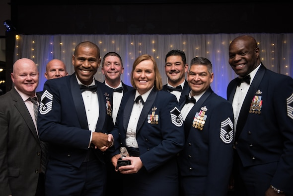 Master Sgt. Eileen Safford, 940th Maintenance Group training manager, receives the Chief's Award for Excellence from the 940th Air Refueling Wing's chief master sergeants.