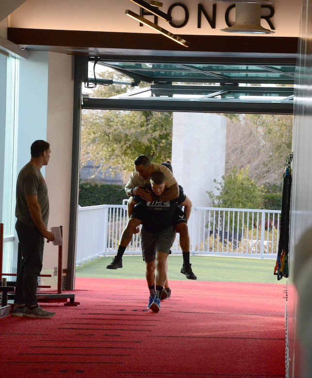 A special warfare Airman and Ultimate Fighting Championship fighter Stephen Thompson conduct a rigorous workout as UFC fighter Forrest Griffin looks on during a video production at the UFC Performance Institute in Las Vegas, Nevada.