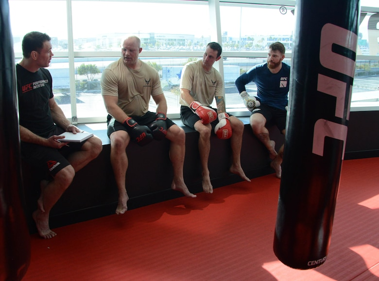 Special warfare Airmen and UFC fighters Forrest Griffin (left) and Paul Felder (right) discuss their workout during a production at the Ultimate Fighting Championship Performance Institute in Las Vegas, Nevada.