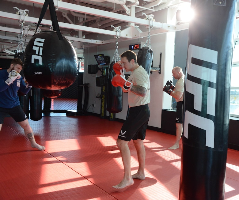 UFC fighter Paul Felder and a pair of special warfare Airmen conduct a grueling punching bag workout during a filming at the Ultimate Fighting Championship Performance Institute in Las Vegas, Nevada.