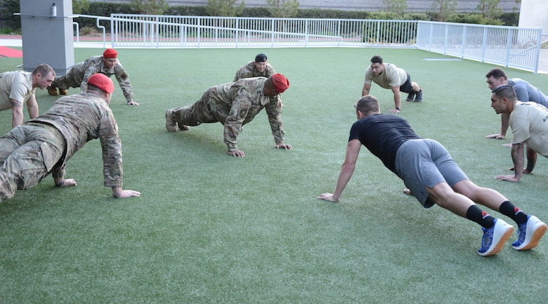 Special warfare Airmen perform memorial push-ups, alongside Ultimate Fighting Championship fighters Forrest Griffin and Stephen Thompson during a fliming at the UFC Performance Institue in Las Vegas, Nevada.