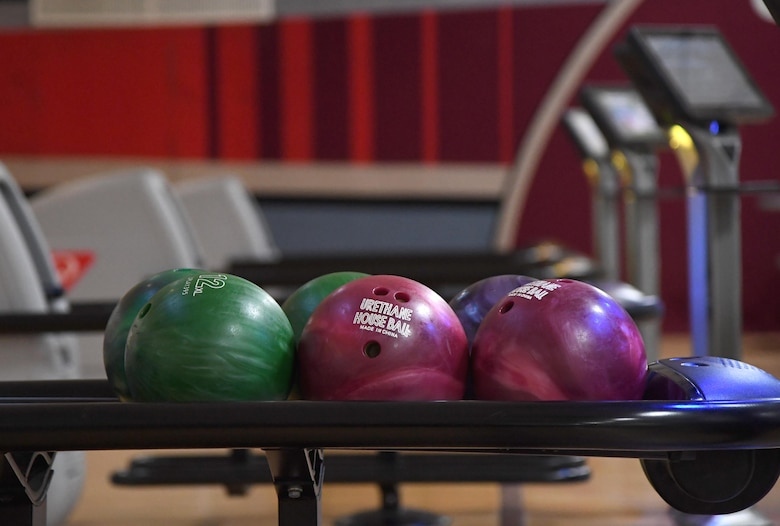 Bowling balls are displayed during the grand re-opening of the Gaude Lanes Bowling Center at Keesler Air Force Base, Mississippi, Feb. 7, 2020. Renovations in the 11th Frame Cafe includes more space, new furniture and light fixtures and the addition of a grab-n-go section. (U.S. Air Force photo by Kemberly Groue)