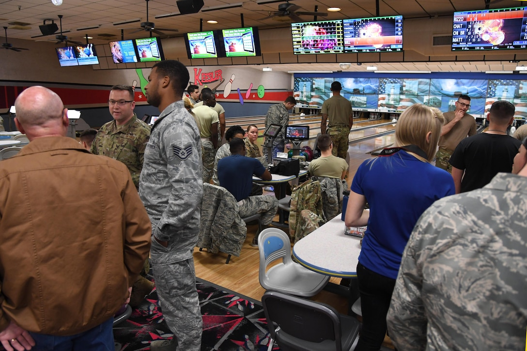 Keesler personnel gather during the grand re-opening of the Gaude Lanes Bowling Center at Keesler Air Force Base, Mississippi, Feb. 7, 2020. Renovations in the 11th Frame Cafe includes more space, new furniture and light fixtures and the addition of a grab-n-go section. (U.S. Air Force photo by Kemberly Groue)