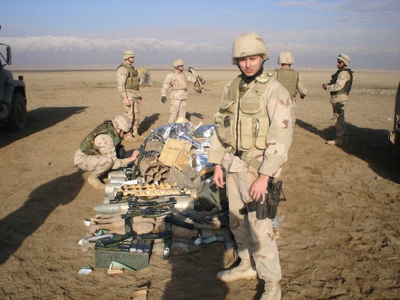 Keith Corcoran, an Airman First Class in security forces at the time, poses for a photo while on deployment to Afghanistan between 2004 and 2005.  Corcoran and his comrades provided installation security, protected convoys, interacted with local war lords, seized weapons caches and conducted humanitarian operations. (Courtesy Photo)