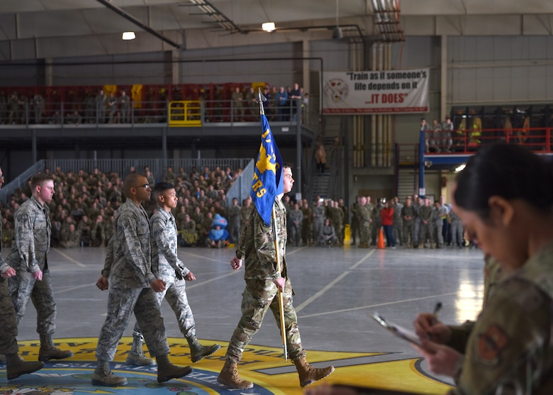 U.S. Air Force students from the 316th Training Squadron march during the 17th Training Group Drill Competition at the Louis F. Garland Department of Defense Fire Academy High Bay on Goodfellow Air Force Base, Texas, Feb. 7, 2020. The competing squadrons were judged based on military bearing, drill movement and executing precision. (U.S. Air Force photo by Airman 1st Class Abbey Rieves)