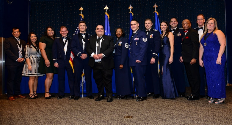 The Air Force Nuclear Weapons Center commander, Maj. Gen. Shaun Morris, congratulates the center's annual award winners at a ceremony on Jan. 23, 2020, at the Mountain View Club, Kirtland AFB, New Mexico.  Pictured left to right: William Ramos; Paola Banuelos; Gabriella Gutierrez; 1st Lt. Andrew Miller; 2nd Lt. MacKenzie Lerum; Jonathan Holguin; Master Sgt. Latoya Saxton; Technical Sgt. Robert Jovin; Capt. Blake Branton; Katherine Schneider; Maj. Christopher Ifft; Clarence Perry; Morris; and Michelle Rivera. See story for complete list of winners. (Air Force photo by Senior Airman Alexandria Crawford)