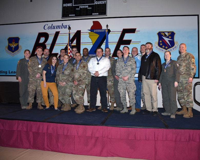The 2019 14th Flying Training Wing's Annual Award stand on stage after being presented their awards from 17 separate categories Feb. 9, 2020 on Columbus Air Force Base, Miss. (U.S. Air Force photo by Senior Airman Keith Holcomb)