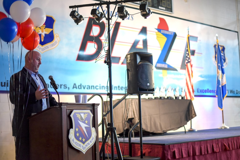 Jason Trufant, Mississippi University for Women's athletics director, speaks at the 2019 14th Flying Training Wing's Annual Awards Banquet Feb. 9, 2020, on Columbus Air Force Base, Miss. Trufant is the son and grandson of U.S. Air Force veterans and a community member involved with Team BLAZE. (U.S. Air Force photo by Senior Airman Keith Holcomb)