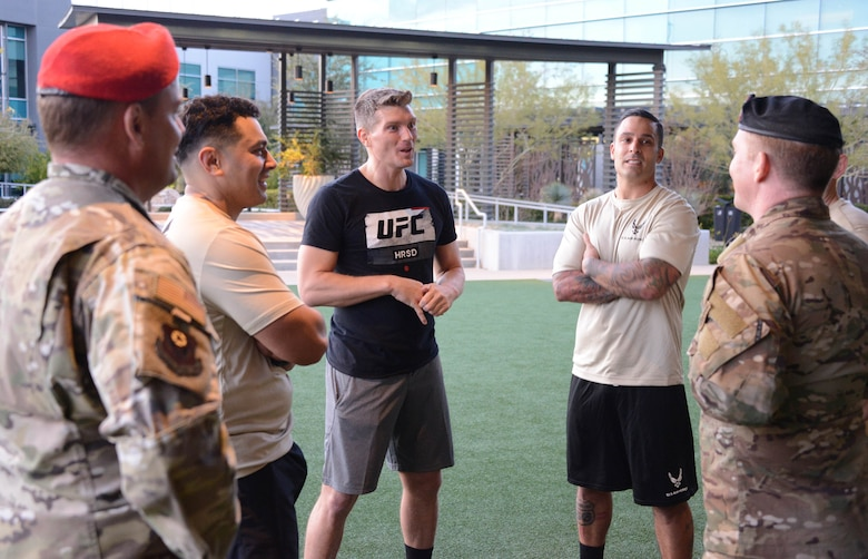 Special warfare Airmen share stories with UFC fighter Stephen Thompson during a filming at the Ultimate Fighting Championship Performance Institute in Las Vegas, Nevada.