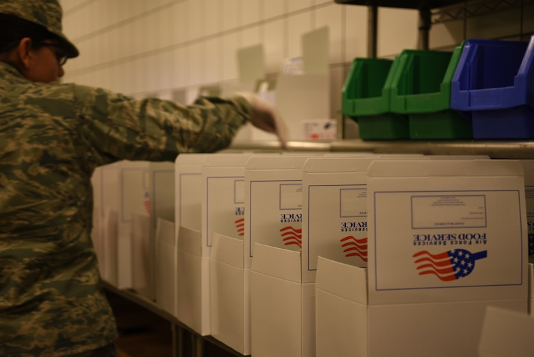U.S. Air Force Jessica Muniz, 786th Force Support Squadron food service apprentice, builds box meals at the Jawbone Flight Kitchen at Ramstein Air Base, Germany, Feb. 6, 2020.