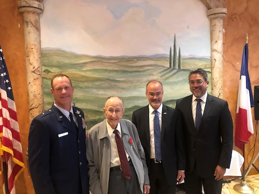 Long-time San Antonio resident and United States Army Air Corps World War II veteran Roland Dullnig (second from left) stands with U.S. Air Force Brig. Gen. James Sears (left), Air Education and Training Command director of plans, programs and requirements, as well as the Consul General of France in Houston, Alexis Andres (second from right) and Robert Travino (right), San Antonio City Councilman District One, after being presented the French Legion of Honor medal in a ceremony which included family and friends in San Antonio, Texas, Feb. 8, 2020.  The French Legion of Honor is a prestigious medal and has been recently awarded by the people of France to American Veterans who fought for the liberation of France during World War II. (U.S. Air Force photo / Maj. Kim Garbett)