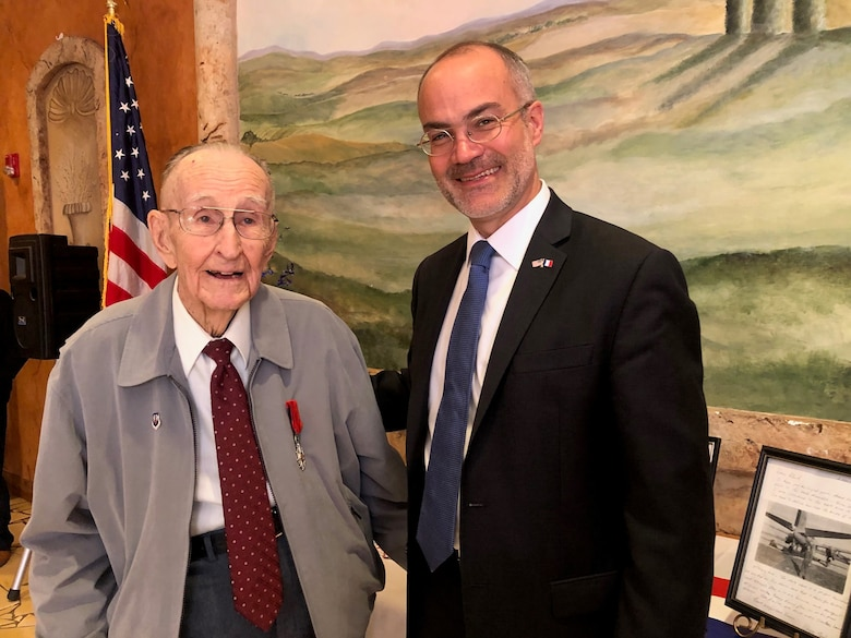 Long-time San Antonio resident and United States Army Air Corps World War II veteran Roland Dullnig (left) stands with the Consul General of France in Houston, Alexis Andres, after being presented the French Legion of Honor medal in a ceremony which included family and friends in San Antonio, Texas, Feb. 8, 2020.  The French Legion of Honor is a prestigious medal and has been recently awarded by the people of France to American Veterans who fought for the liberation of France during World War II. (U.S. Air Force photo / Maj. Kim Garbett)
