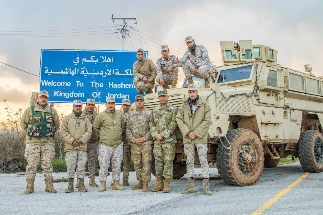 Jordan Armed Forces-Arab Army (JAF) Soldiers pose for a photo with Military Engagement Team-Jordan, 158th Maneuver Enhancement Brigade, Arizona Army National Guard, during a Mine Resistant Ambush Protected Wheeled Armor Vehicle Subject Matter Expert Exchange at a base outside of Amman, Jordan in January. The U.S. military has a long-standing relationship with Jordan to support our mutual objectives by providing military assistance to the JAF consistent with our national interests. (U.S. Army photo by Sgt. 1st Class Shaiyla B. Hakeem)