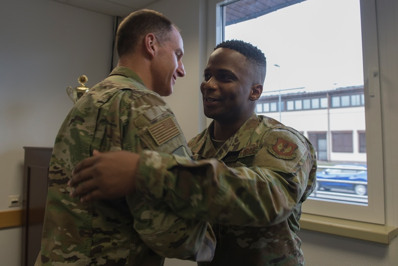 U.S Air Force Col. Matt Husemann, 86th Airlift Wing vice commander, left, congratulates Tech. Sgt. Marcus Bias, 86th AW equal opportunity specialist, on being the Airlifter of the Week at Ramstein Air Base, Germany, Jan. 30, 2020. Bias was recognized for going above and beyond to make the 86th AW the World's Best Wing.