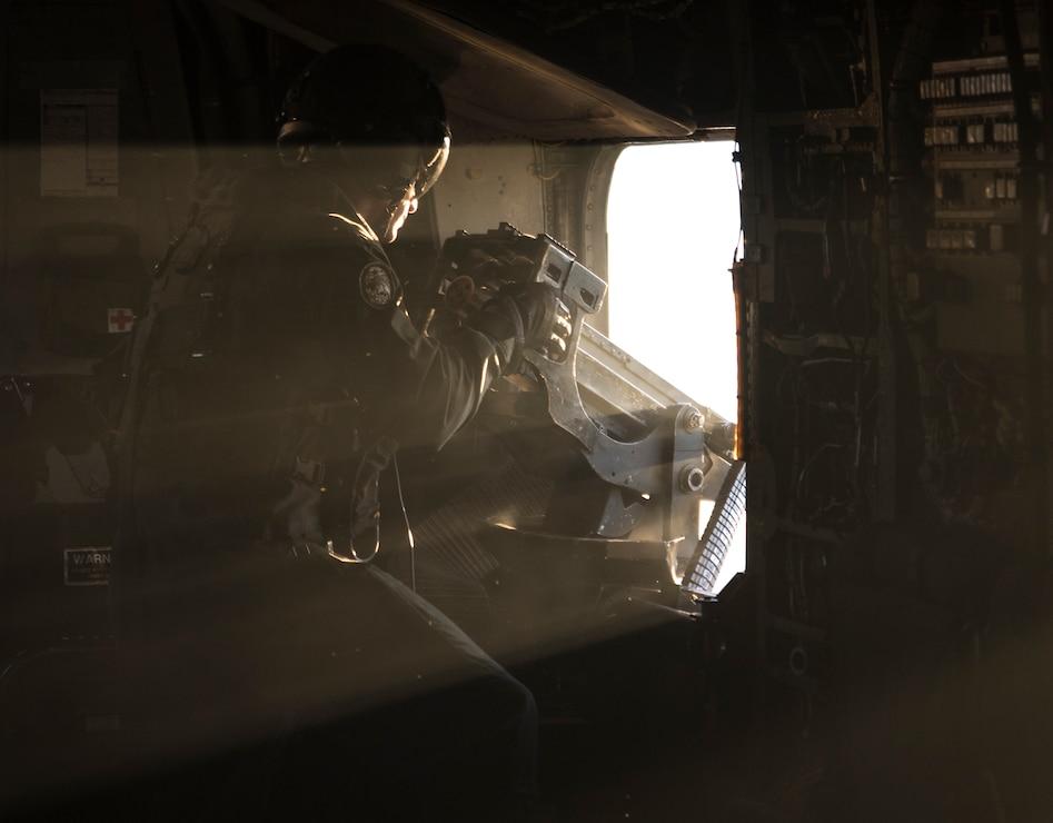A U.S. Marine fires an M2 machine gun from a CH-53E Super Stallion with Marine Heavy Helicopter Squadron 464 during a deployment for training in Savannah, Ga., Feb. 5.