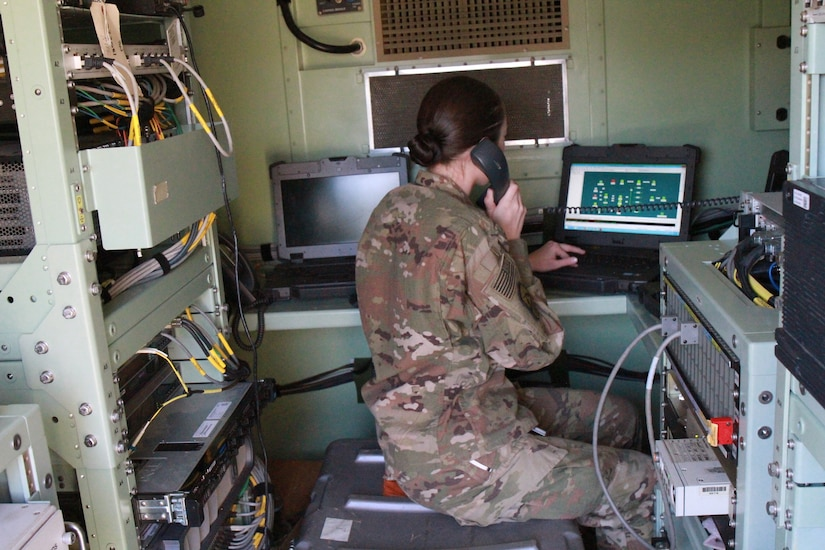 Spc. Annabell Dwiggins, 198th Expeditionary Signal Battalion (ESB), operates the Single Shelter Switch (SSS) during the monthly validation testing. Validation testing occurs every month to ensure that all communication equipment functions properly and also allows Soldiers to evaluate the communication systems and strive for continuous improvement to better support their end users.