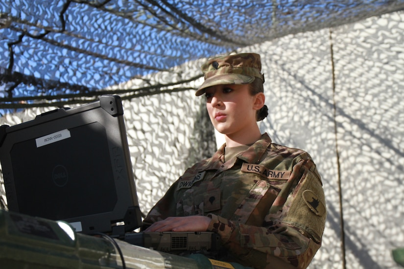 Spc. Annabell Dwiggins, 198th Expeditionary Signal Battalion (ESB), ensures end users have connectivity on a laptop. Validation testing occurs every month to ensure that all communication equipment functions properly and also allows Soldiers to evaluate the communication systems and strive for continuous improvement to better support their end users.