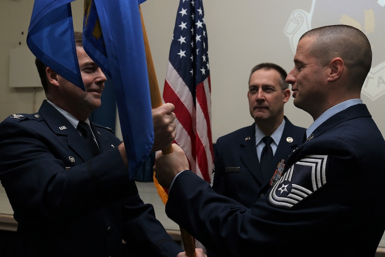 Chief Master Sgt. Paul Frisco relived his authority as the 111 Attack Wing's command chief master sergeant to 111th ATKW Commander Col. Bill Griffin during a ceremony at Horsham Air Guard Station, Pennsylvania, Jan. 8, 2020. Chief Master Sgt. Robert Ferguson accepted authority as the incoming command chief master sergeant during the event. (U.S. Air National Guard Tech. Sgt. Andria Allmond)