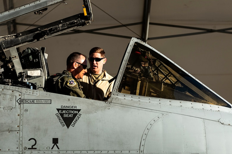 Photo of Airmen discussing aircraft details.