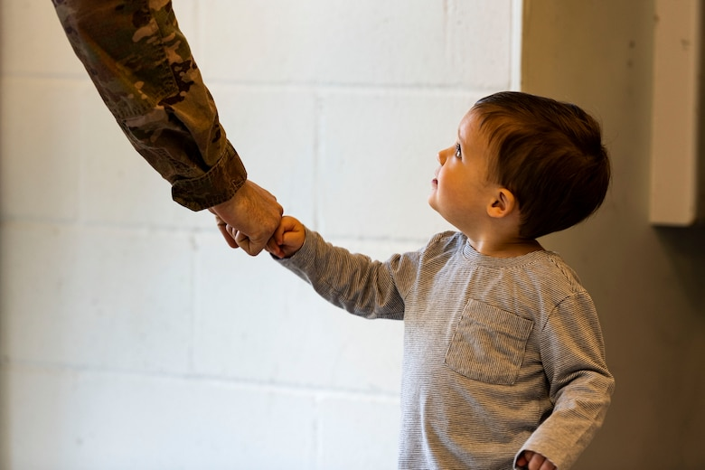 Photo of child greeting an Airman.